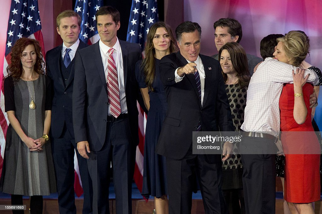 Mitt Romney, Republican presidential candidate, center, points to the crowd following a concession speech as he is surrounded by his family at an election rally at the Boston Convention and Exhibition Center in Boston, Massachusetts, U.S., in the early morning on Wednesday, Nov. 7, 2012. President Barack Obama, the post-partisan candidate of hope who became the first black U.S. president, won re-election today by overcoming four years of economic discontent with a mix of political populism and electoral math. Photographer: Andrew Harrer/Bloomberg via Getty Images