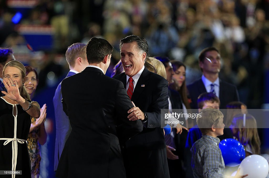 <a gi-track='captionPersonalityLinkClicked' href=/galleries/search?phrase=Mitt+Romney&family=editorial&specificpeople=207106 ng-click='$event.stopPropagation()'>Mitt Romney</a>, Republican presidential candidate, center right, embraces Representative Paul Ryan, vice presidential candidate, after speaking at the Republican National Convention (RNC) in Tampa, Florida, U.S., on Thursday, Aug. 30, 2012. Republican presidential nominee <a gi-track='captionPersonalityLinkClicked' href=/galleries/search?phrase=Mitt+Romney&family=editorial&specificpeople=207106 ng-click='$event.stopPropagation()'>Mitt Romney</a>, a wealthy former business executive who served as Massachusetts governor and as a bishop in the Mormon church, is under pressure to show undecided voters more personality and emotion in his convention speech tonight, even as fiscal conservatives in his own party say he must more clearly define his plans for reining in the deficit and improving the economy. Photographer: Andrew Harrer/Bloomberg via Getty Images