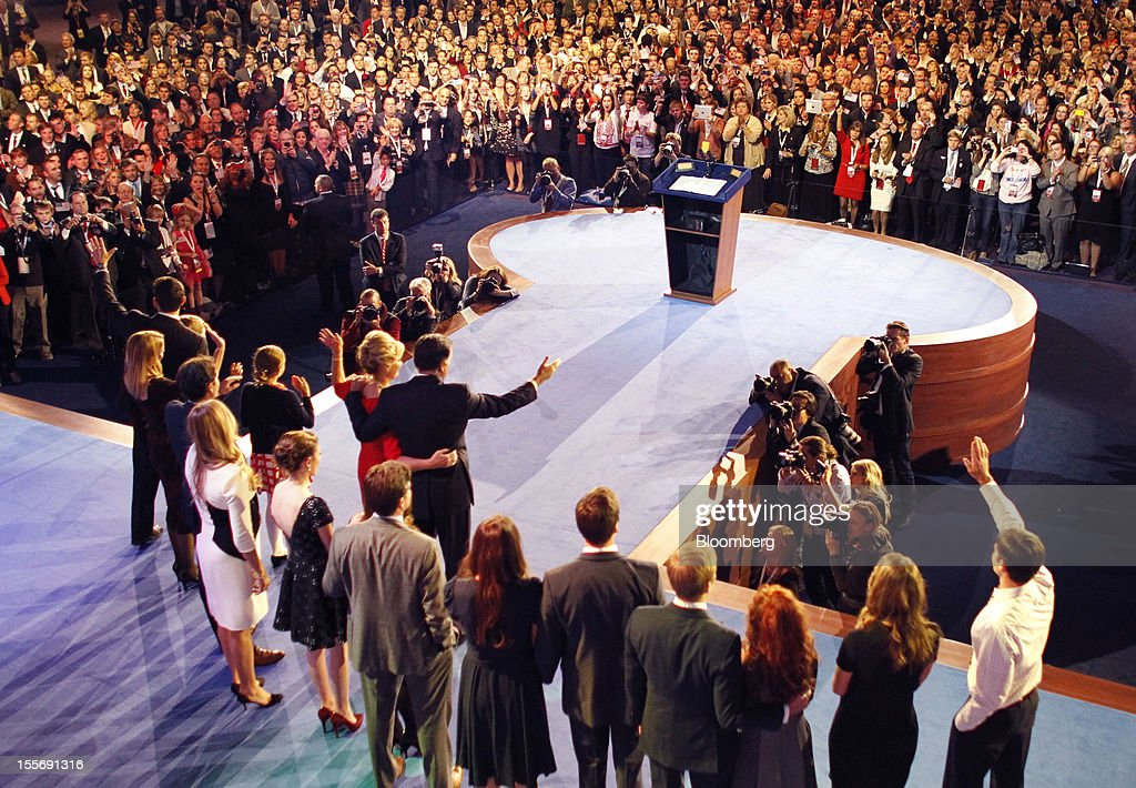 Mitt Romney, Republican presidential candidate, center, stands with his family after delivering his concession speech during his election rally at the Boston Convention and Exhibition Center in Boston, Massachusetts, U.S., in the early morning on Wednesday, Nov. 7, 2012. U.S. President Barack Obama, the post-partisan candidate of hope who became the first black U.S. president, won re-election today by overcoming four years of economic discontent with a mix of political populism and electoral math. Photographer: Rick Wilking/Pool via Bloomberg
