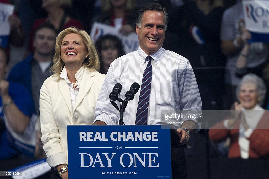 <a gi-track='captionPersonalityLinkClicked' href=/galleries/search?phrase=Mitt+Romney&family=editorial&specificpeople=207106 ng-click='$event.stopPropagation()'>Mitt Romney</a>, Republican presidential candidate, right, and wife <a gi-track='captionPersonalityLinkClicked' href=/galleries/search?phrase=Ann+Romney&family=editorial&specificpeople=868004 ng-click='$event.stopPropagation()'>Ann Romney</a> react during a campaign rally at the Verizon Wireless Center in Manchester, New Hampshire, U.S., on Monday, Nov. 5, 2012. President Barack Obama beseeched core supporters and wayward backers to go to the polls, while Romney reached for an upset victory powered by anti-incumbent fervor on the final full day of a race that polls suggest has tilted slightly in the president's favor. Photographer: Andrew Harrer/Bloomberg via Getty Images