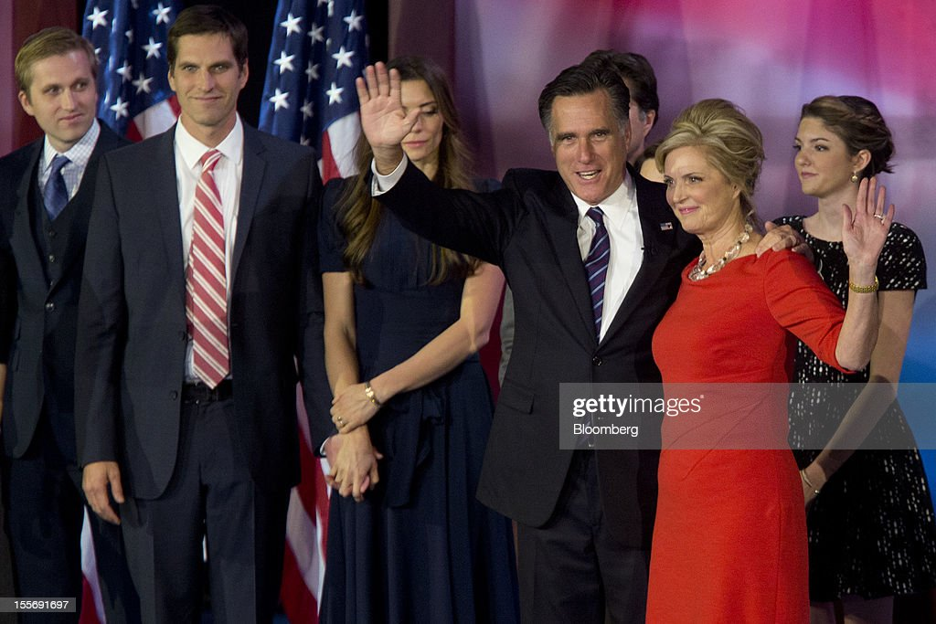 <a gi-track='captionPersonalityLinkClicked' href=/galleries/search?phrase=Mitt+Romney&family=editorial&specificpeople=207106 ng-click='$event.stopPropagation()'>Mitt Romney</a>, Republican presidential candidate, third right, and wife <a gi-track='captionPersonalityLinkClicked' href=/galleries/search?phrase=Ann+Romney&family=editorial&specificpeople=868004 ng-click='$event.stopPropagation()'>Ann Romney</a>, second right, wave to the crowd following his concession speech during an election rally at the Boston Convention and Exhibition Center in Boston, Massachusetts, U.S., in the early morning on Wednesday, Nov. 7, 2012. President Barack Obama, the post-partisan candidate of hope who became the first black U.S. president, won re-election today by overcoming four years of economic discontent with a mix of political populism and electoral math. Photographer: Andrew Harrer/Bloomberg via Getty Images
