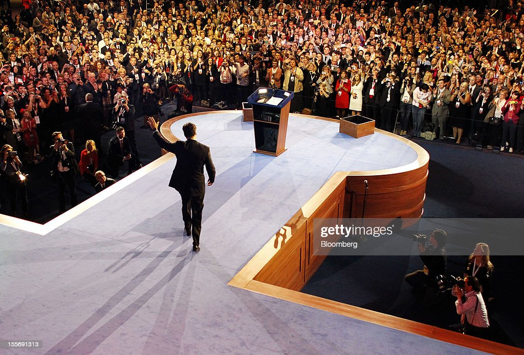 Mitt Romney, Republican presidential candidate, waves as he arrives to make a speech during his election rally at the Boston Convention and Exhibition Center in Boston, Massachusetts, U.S., in the early morning on Wednesday, Nov. 7, 2012. U.S. President Barack Obama, the post-partisan candidate of hope who became the first black U.S. president, won re-election today by overcoming four years of economic discontent with a mix of political populism and electoral math. Photographer: Rick Wilking/Pool via Bloomberg