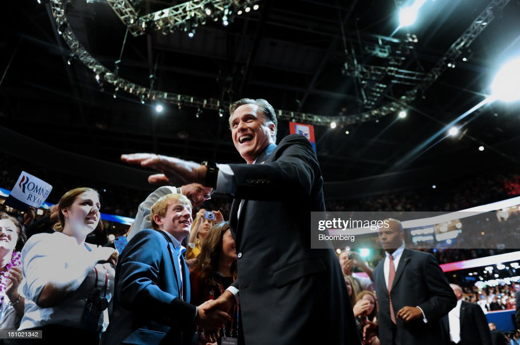Mitt Romney, Republican presidential candidate, waves while greeting delegates before speaking at the Republican National Convention (RNC) in Tampa, Florida, U.S., on Thursday, Aug. 30, 2012. Romney, a wealthy former business executive who served as Massachusetts governor and as a bishop in the Mormon church, is under pressure to show undecided voters more personality and emotion in his convention speech tonight, even as fiscal conservatives in his own party say he must more clearly define his plans for reining in the deficit and improving the economy. Photographer: Daniel Acker/Bloomberg via Getty Images
