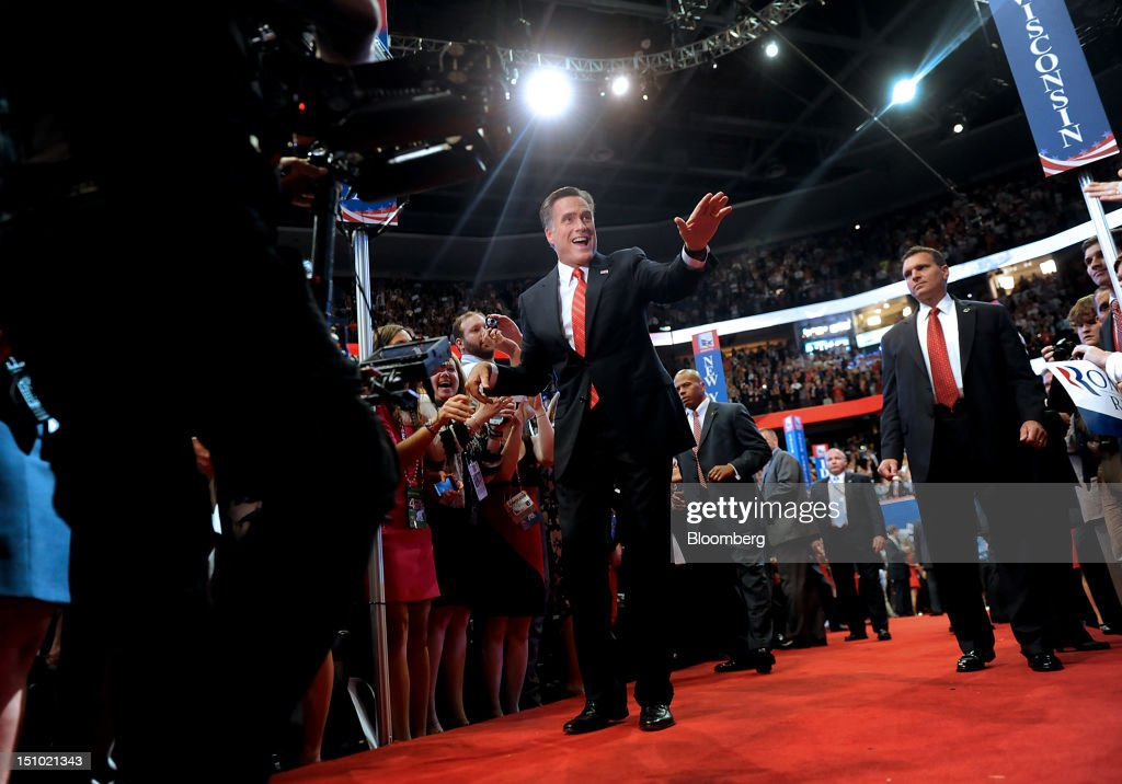 <a gi-track='captionPersonalityLinkClicked' href=/galleries/search?phrase=Mitt+Romney&family=editorial&specificpeople=207106 ng-click='$event.stopPropagation()'>Mitt Romney</a>, Republican presidential candidate, waves while greeting delegates before speaking at the Republican National Convention (RNC) in Tampa, Florida, U.S., on Thursday, Aug. 30, 2012. Romney, a wealthy former business executive who served as Massachusetts governor and as a bishop in the Mormon church, is under pressure to show undecided voters more personality and emotion in his convention speech tonight, even as fiscal conservatives in his own party say he must more clearly define his plans for reining in the deficit and improving the economy. Photographer: Daniel Acker/Bloomberg via Getty Images