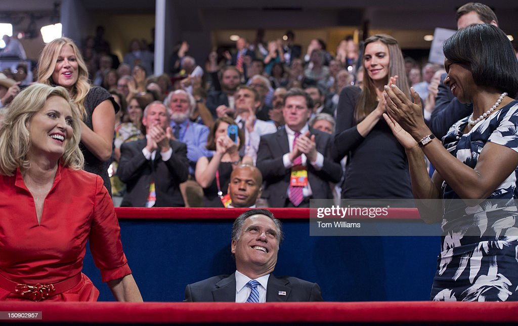 Mitt Romney, republican presidential nominee, receives applause from his wife Ann, left, and Condoleeza Rice, former Secretary of State, after Ann, delivered a speech on the floor of the Republican National Convention in the Tampa Bay Times Forum.