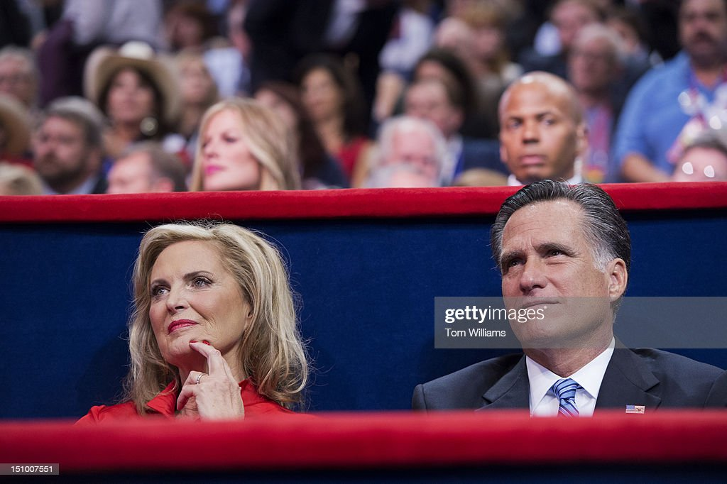 Mitt Romney, Republican presidential nominee, sits with his wife Ann, after she delivered her speech on the floor of the Republican National Convention in the Tampa Bay Times Forum.