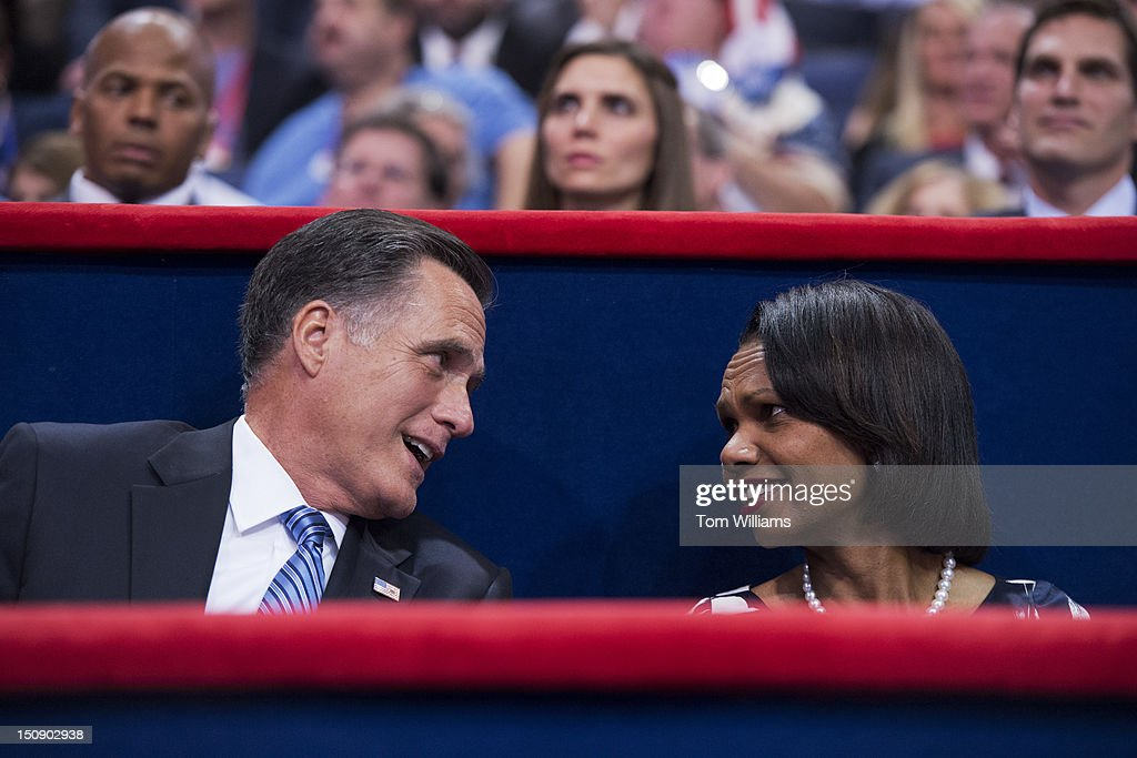 Mitt Romney, republican presidential nominee, talks with Condoleezza Rice, former Secretary of State, after Romney's wife Ann, delivered a speech on the floor of the Republican National Convention in the Tampa Bay Times Forum.