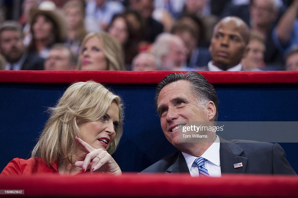 Mitt Romney, republican presidential nominee, talks with his wife Ann, after she delivered a speech on the floor of the Republican National Convention in the Tampa Bay Times Forum.