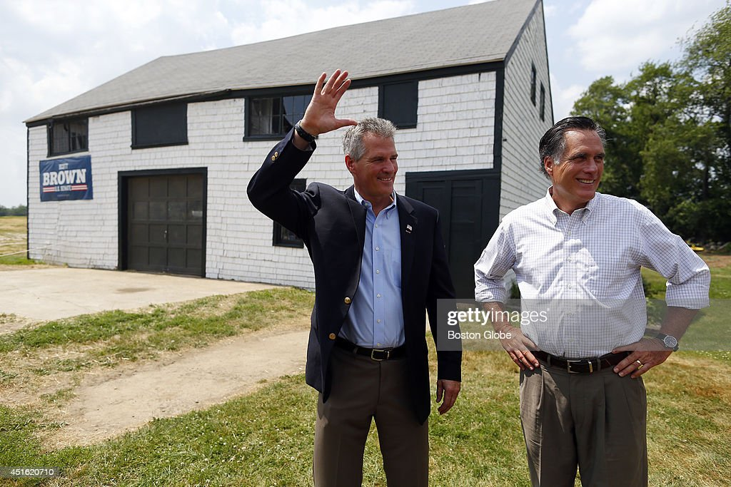 Mitt Romney, right, and Scott Brown stand beside each other at Bittersweet Farm shortly before Romney endorsed Brown in Stratham, New Hampshire July 2, 2014.