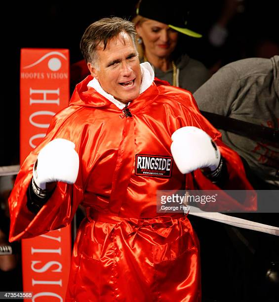 Mitt Romney taunts Evander Holyfield before a charity boxing event on May 15 2015 in Salt Lake City Utah The event was held to raise money for...