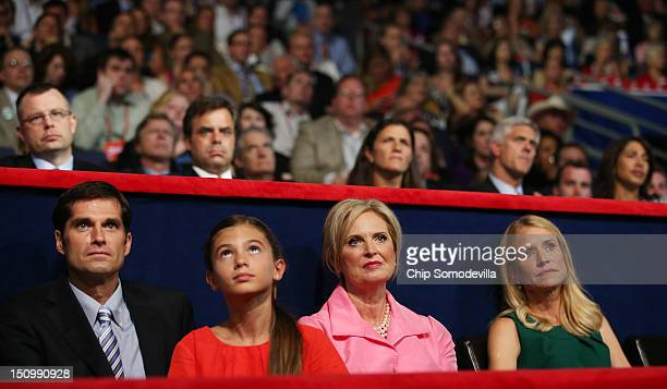 Mitt Romney's son Matt Romney and daughter Chloe Romney Romney's wife Ann Romney Paul Ryan's wife Janna Ryan sit in the VIP box during the third day...