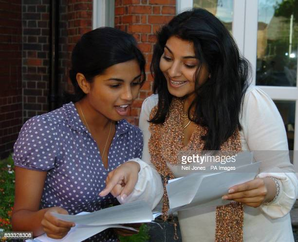 Mitu Shrotri and Mariyh Selmi celebrate their 8 A*s and 1 A GCSE results at Merchant Taylors' Girls' School in Crosby Liverpool