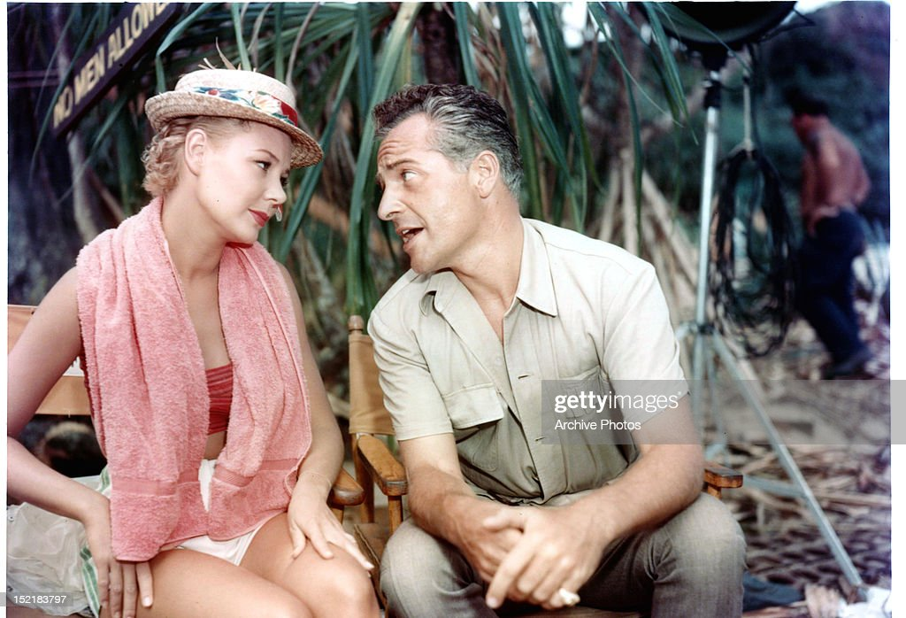 Mitzi Gaynor and Rossano Brazzi sitting together in between scenes from the film 'South Pacific' 1958