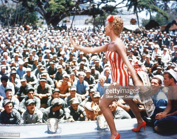 Mitzi Gaynor US actress singer and dancer wearing a striped redandwhite striped leotard on stage performing for the troops in a publicity still...