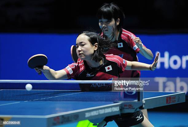 Miu Hirano and Mima Ito of Japan in action during the Women's Doubles semi final of the 2014 ITTF World Tour Grand Finals at Huamark Indoor Stadium...