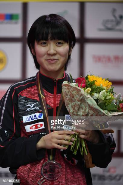 Miu Hirano of Japan celebrates the Bronze medal the first for Japan in womens singles since Toshiko Kowada won the gold and Miho Hamada a bronze at...