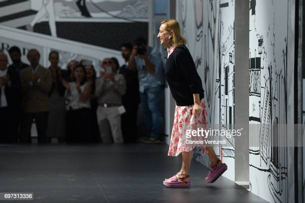 Miuccia Prada acknoledges the audience after the Prada show during Milan Men's Fashion Week Spring/Summer 2018 on June 18 2017 in Milan Italy