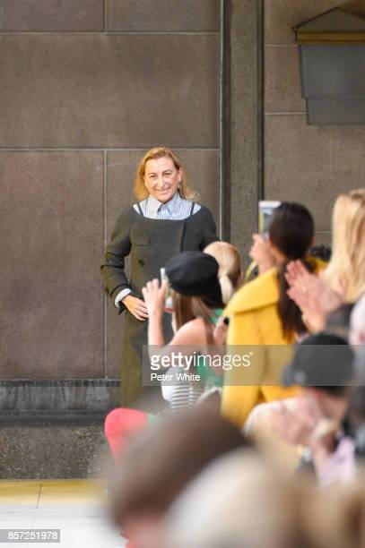 Miuccia Prada acknowledges the audience at the end of the Miu Miu Paris show as part of the Paris Fashion Week Womenswear Spring/Summer 2018 on...