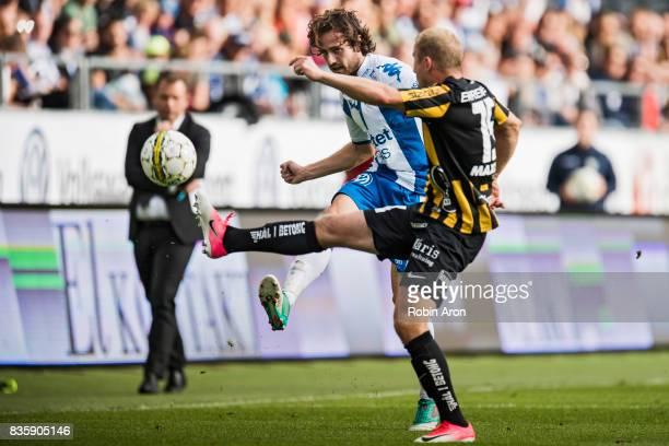 Mix Diskerud of IFK Goteborg shoots and Kari Arkivuo of BK Hacken tries to stop him during the Allsvenskan match between IFK Goteborg and BK Hacken...