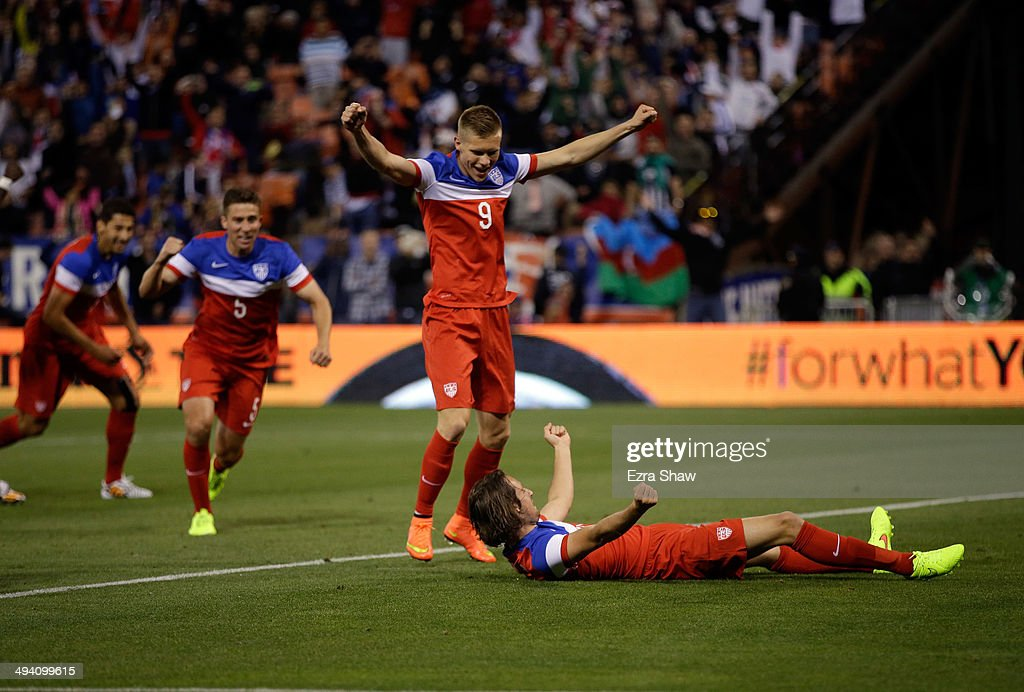 Mix Diskerud #10 of the United States celebrates with Aron Johannsson #9 and <a gi-track='captionPersonalityLinkClicked' href=/galleries/search?phrase=Matt+Besler&family=editorial&specificpeople=5664004 ng-click='$event.stopPropagation()'>Matt Besler</a> #5 after during he scored a goal against Azerbaijan during their match at Candlestick Park on May 27, 2014 in San Francisco, California.