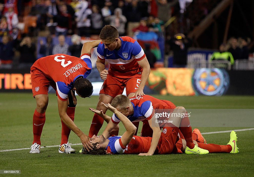 Mix Diskerud #10 of the United States celebrates with Aron Johannsson #9, <a gi-track='captionPersonalityLinkClicked' href=/galleries/search?phrase=Matt+Besler&family=editorial&specificpeople=5664004 ng-click='$event.stopPropagation()'>Matt Besler</a> #5, and <a gi-track='captionPersonalityLinkClicked' href=/galleries/search?phrase=Omar+Gonzalez&family=editorial&specificpeople=2488485 ng-click='$event.stopPropagation()'>Omar Gonzalez</a> #3 after he scored a goal against Azerbaijan during their match at Candlestick Park on May 27, 2014 in San Francisco, California.