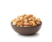 Mix nuts with wooden bowl , isolated on white