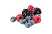 Mix of berries. Raspberries, blueberries and blackberries on a white background. Isolated.