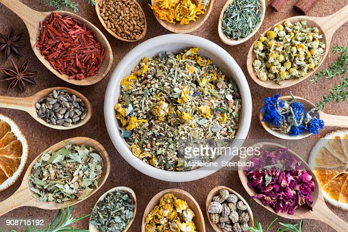 Mix of dried herbs on wooden spoons, top view. : Stock Photo