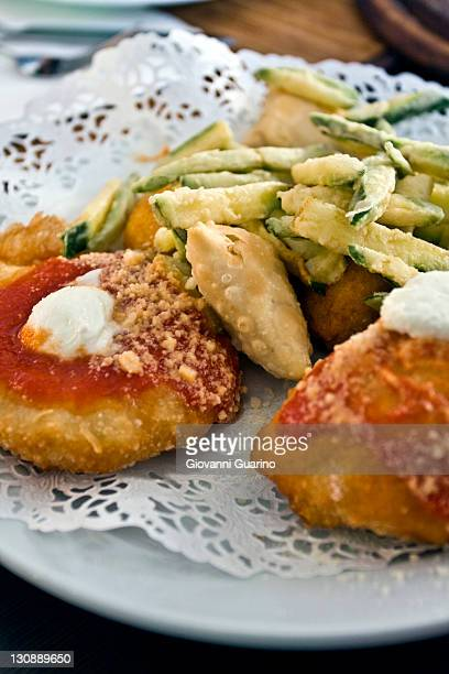 Mix of fried appetizers with Montanara pizza and fried zucchini, Italian fries