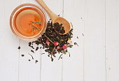 Mix of green and black tea on white background