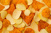 Heap of potato and tortilla chips background