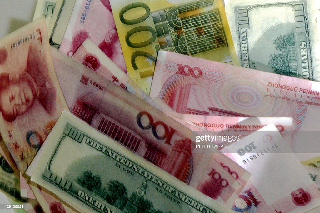 A mix of the Chinese currency the yuan the US dollar and the euro are pictured in Beijing 22 July 2005 China's central bank said the yuan will be...