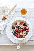 Mixed berries with banana and honey