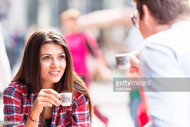 Mixed couple drinking Turkish Coffee