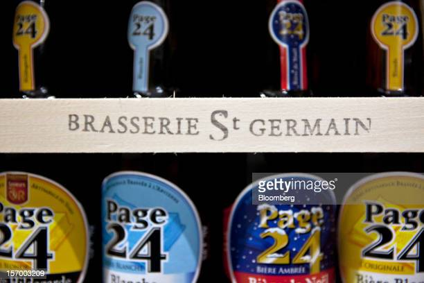 A mixed crate of Page 24 beers made up of Blonde Blanche Ambree and Original produced by the brewer Brasserie Saint Germain are seen in a wooden...