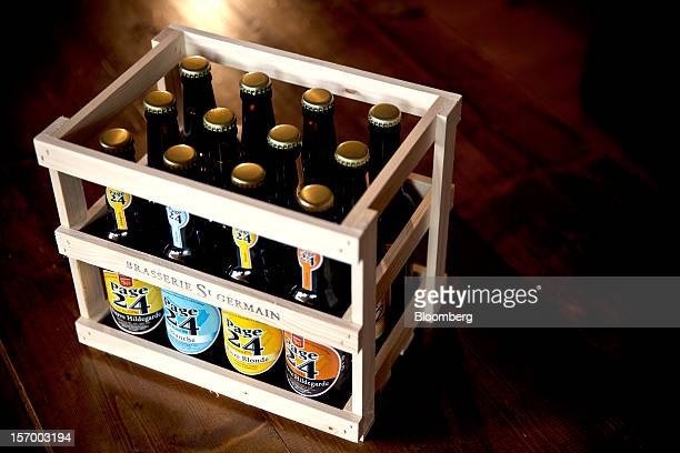 A mixed crate of Page 24 beers made up of Blonde Blanche Original and Ambree produced by the brewer Brasserie Saint Germain are seen stored at the...