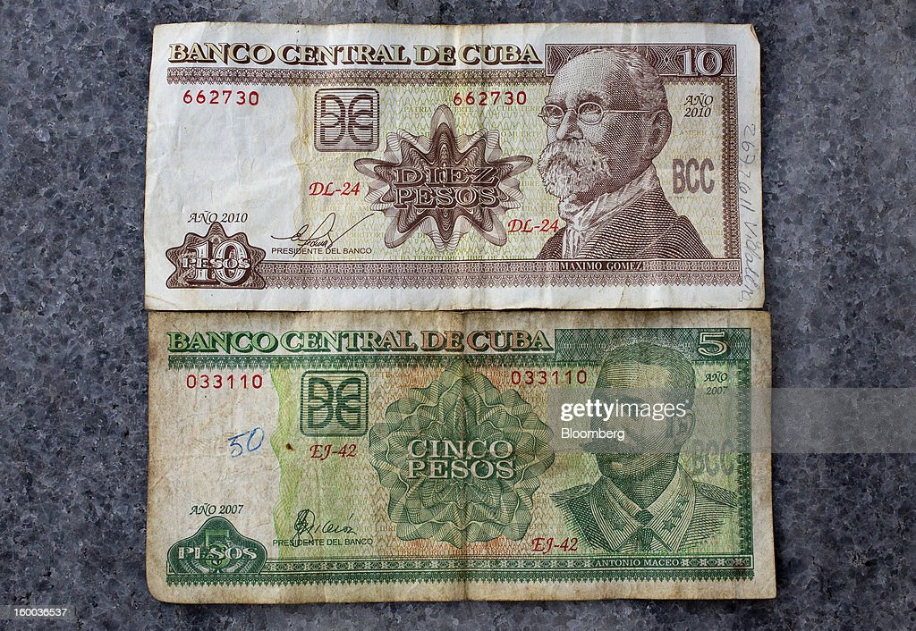 Mixed denomination non-convertible peso, or 'chavito,' notes, one of two official currencies in Cuba, are seen in this arranged photograph in Havana, Cuba, on Thursday, Jan. 17. 2013. In a country where the average monthly salary is $19, according to Cuba's statistics agency, even buying an airplane ticket will be beyond the reach of most of the island's 11 million residents as President Raul Castro begins easing travel rules on the communist island. Photographer: Andrey Rudakov/Bloomberg via Getty Images