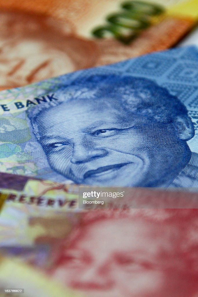 Mixed denomination rand currency banknotes are arranged for a photograph at a First National Bank (FNB) branch in Johannesburg, South Africa, on Friday, March 15, 2013. A recovery in mining and manufacturing is giving South Africa's rand and bonds a breather amid concern that growth is slowing while inflation accelerates. Photographer: Nadine Hutton/Bloomberg via Getty Images