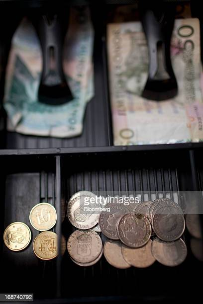 Mixed denomination Swedish kronor notes and coins sit in a cashier's till inside a currency exchange in Malmo Sweden on Tuesday May 14 2013 Sweden's...