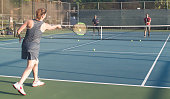 Mixed doubles tennis lesson in summer in Los Angeles