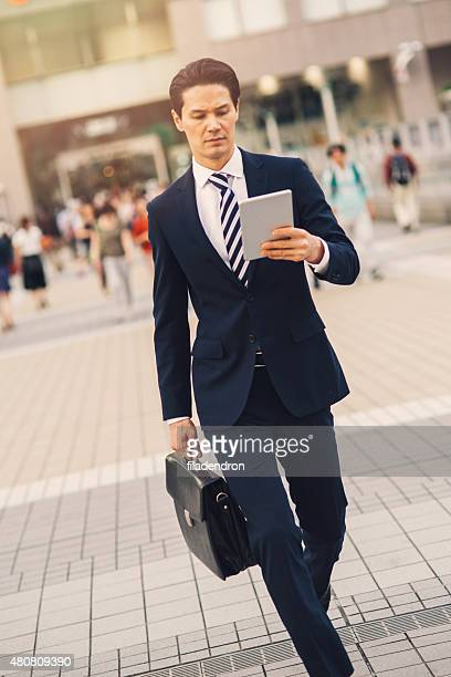 Mixed ethnicity businessman using tablet