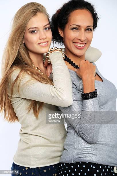 Mixed ethnicity women on fashion photo shooting