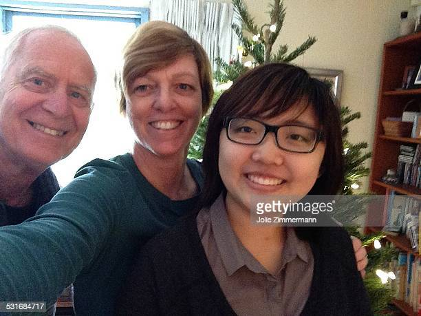 Mixed family of three Christmas selfie