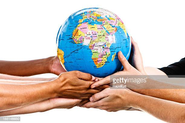 Mixed hands stretch out to support world globe Africa uppermost