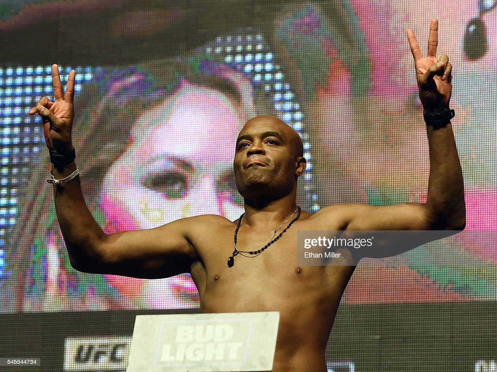 Mixed martial artist Anderson Silva poses on the scale during his weighin for UFC 200 at TMobile Arena on July 8 2016 in Las Vegas Nevada Silva will...