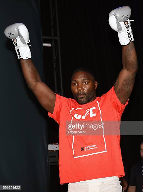 Mixed martial artist Anthony Johnson gestures as he arrives at an open workout for UFC 202 at Rocks Lounge at the Red Rock Casino on August 18 2016...