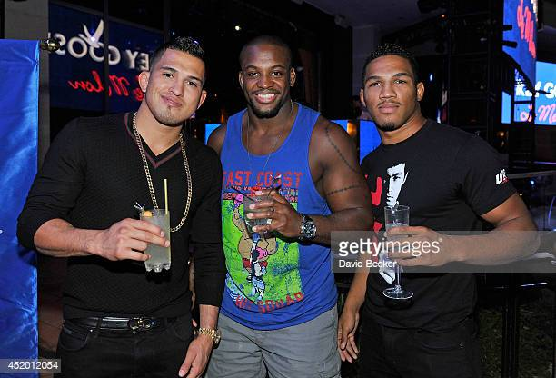 Mixed martial artist Anthony Pettis Eddie Gordon and Kevin Lee appear during the Grey Goose Le Melon Fruit of Kings party at XS The Nightclub at...