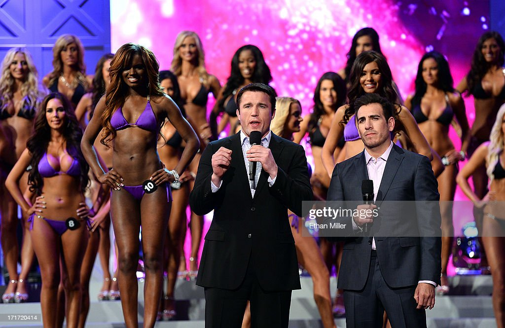 Mixed martial artist <a gi-track='captionPersonalityLinkClicked' href=/galleries/search?phrase=Chael+Sonnen&family=editorial&specificpeople=5434559 ng-click='$event.stopPropagation()'>Chael Sonnen</a> (L) and former mixed martial artist <a gi-track='captionPersonalityLinkClicked' href=/galleries/search?phrase=Kenny+Florian&family=editorial&specificpeople=4453190 ng-click='$event.stopPropagation()'>Kenny Florian</a> stand in front of contestants as they host the 17th annual Hooters International Swimsuit Pageant at The Joint inside the Hard Rock Hotel & Casino on June 27, 2013 in Las Vegas, Nevada.