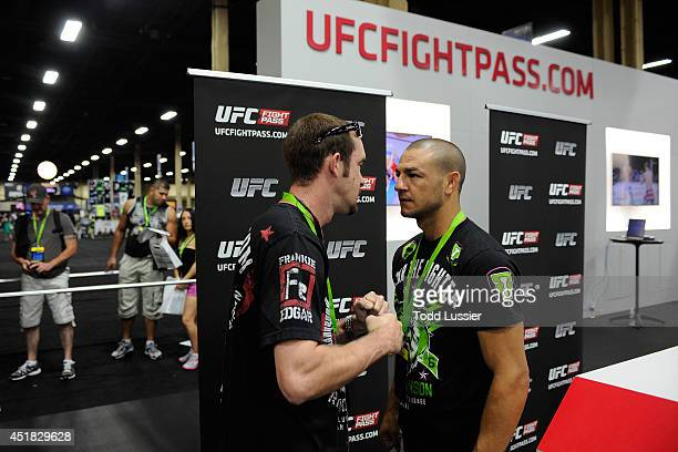 Mixed martial artist Cub Swanson stares down a fan during the UFC Fan Expo 2014 during UFC International Fight Week at the Mandalay Bay Convention...