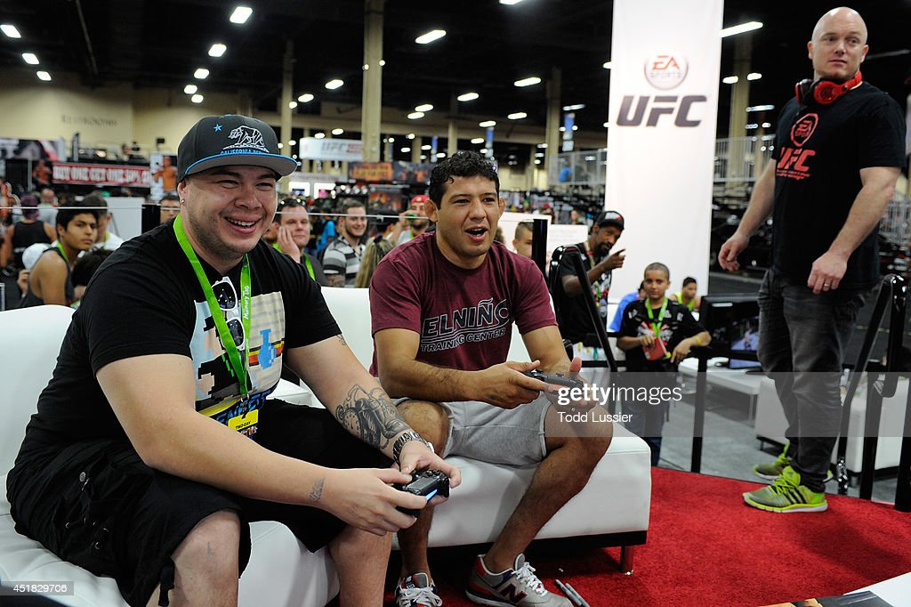 Mixed martial artist Gilbert Melendez plays the new EA UFC video game with fans during the UFC Fan Expo 2014 during UFC International Fight Week at...
